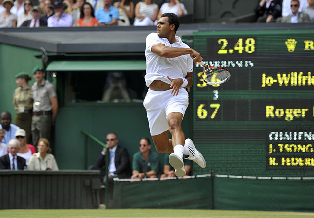 France's Jo-Wilfried Tsonga hits a return during Wednesday's quarterfinal match against Switzerland's Roger Federer.