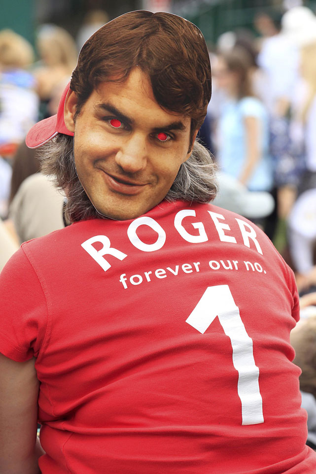 A spectator wears a mask depicting Roger Federer.