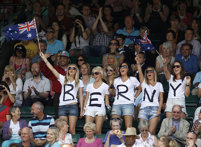 Fans of Bernard Tomic stand on Court 1 before his quarterfinal match against Novak Djokovic.