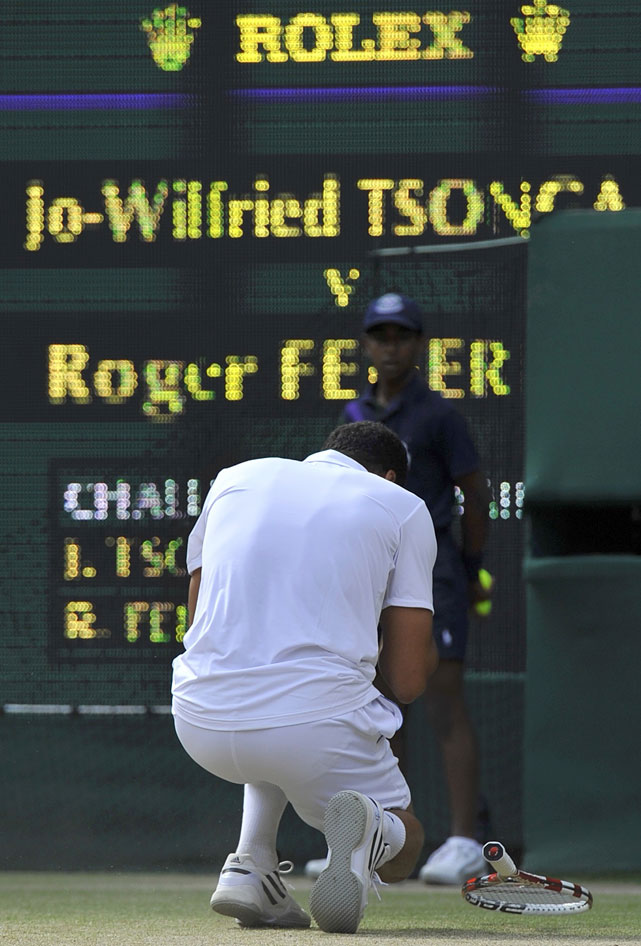 Jo-Wilfried Tsonga reacts after defeating Roger Federer.