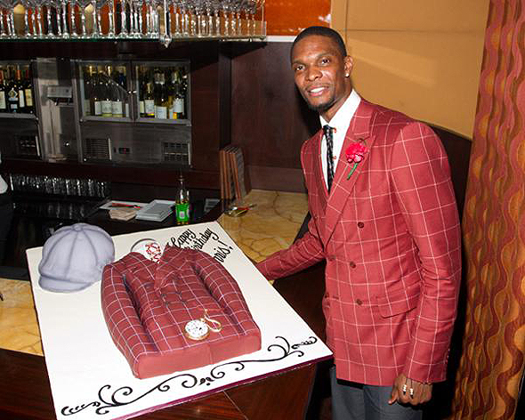Chris Bosh celebrated his 28th birthday with a cake that matched his outfit.