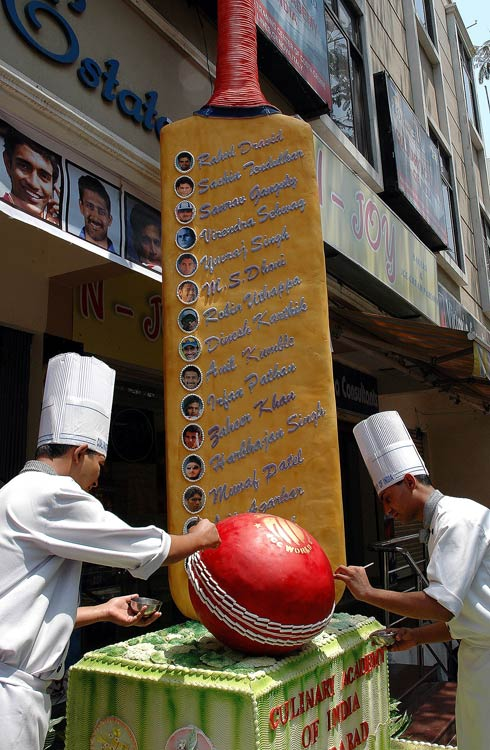Now THIS is a cake. Students at the Culinary Academy of India built an edible 15-foot-by-2-foot cricket bat and 60-inch ball for the national cricket team. Three chefs, assisted by 30 student chefs used 200 kilograms of icing sugar, 300 egg whites, five kilograms of gelatin and 20 kilograms of corn flour and spent 120 hours of work on the cake, just to wish the Indian cricket team luck during the Cricket World Cup 2007.