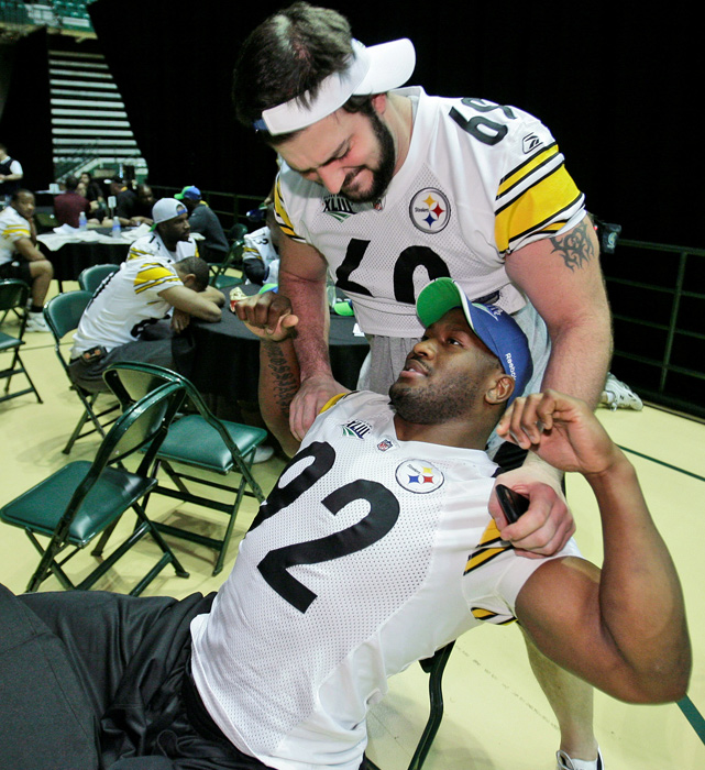 Harrison reclines as he and offensive tackle Jason Capizzi pass the time at Super Bowl XLIII media day in Tampa.