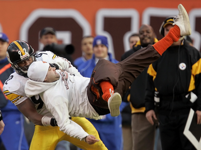"James Harrison is in the news for a controversial interview with  Men's Journal  in which he claimed that if NFL Commissioner Roger Goodell ""was on fire and I had to piss to put him out, I wouldn't do it.""    In this photo, Harrison takes care of a field-rushing Browns fan during Pittsburgh's 41-0 beatdown of the Browns."