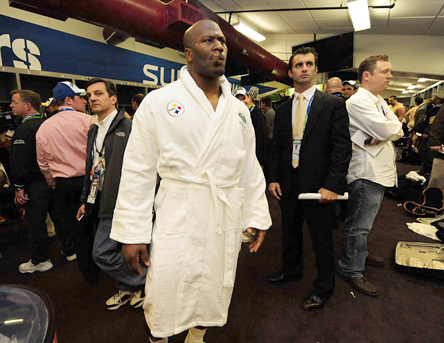 Harrison after Super Bowl XLIII, dressed in a white robe, as if he were a heavyweight boxer. While he does tip the scales at 240 pounds, Harrison is only six feet tall.
