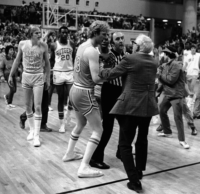 During his second season at ISU, Bird was named an All-America and led his team to the NIT quarterfinals, where it lost to Rutgers, 57-56, after a controversial ending. In this photo, Bird and coach Bob King confront a referee after the buzzer. Both felt a foul should have been called on the game's final play.