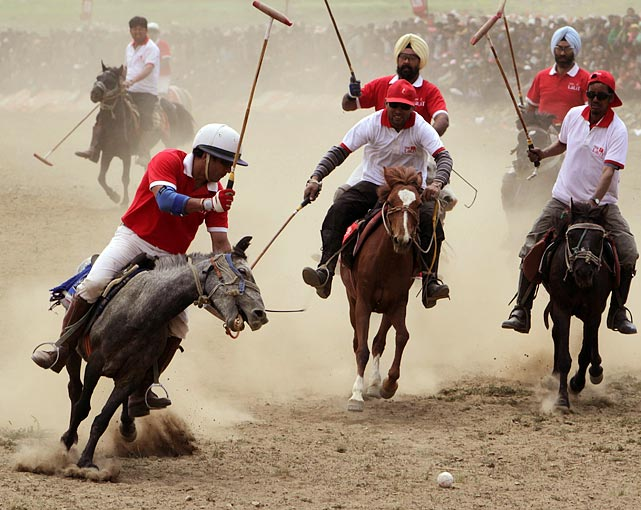 Polo players take part in the final match of a tournament in Dras, India, on July 9. Despite Dras being one of the coldest places on earth inhabited by mankind, polo is the most popular sport in the region.