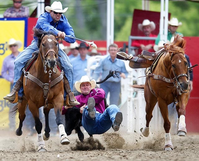 Bill Bugenig leaps from his horse and wrestles a steer to the ground in the Calgary Stampede on July 10. The 10-day event dates to 1912.