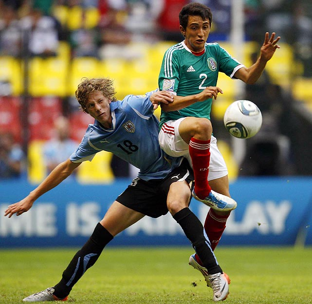 Sebastian Canobra of Uruguay (left) battles with Mexico's Francisco Flores in the FIFA Under 17 World Cup Final. Mexico took the title 2-0 in front of 100,000 fans at the Azteca in Mexico City.