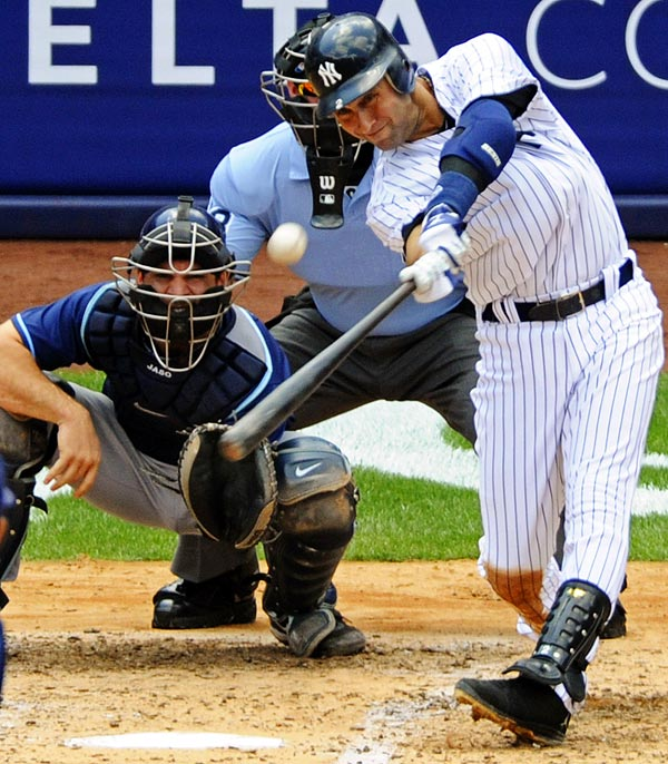 Derek Jeter belts a home run for his 3,000th hit (off Tampa Bay Rays pitcher David Price) on July 9, becoming the 28th player to reach the milestone in MLB history. Jeter went 5-for-5 in front of the home crowd and became the first Yankee in the storied franchise's history to reach 3,000 hits.