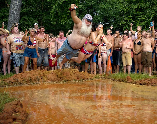 "Robert ""Robo"" Sprague and his wife, Rawni, got hitched in 1998 at the Redneck Games in Georgia. They returned to the 15th annual event, which kicked off July 9, and jumped in the mud-filled pool in a celebration of 13 years of marriage."