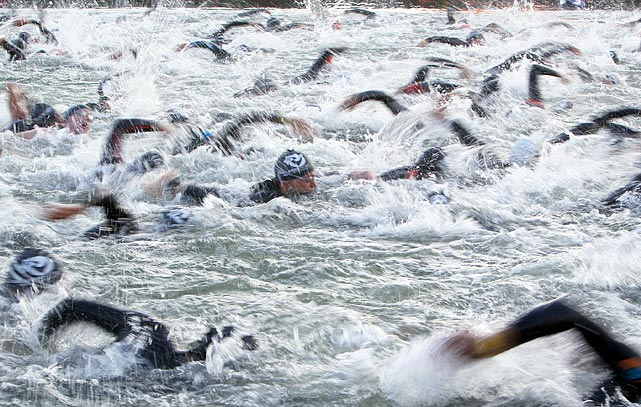Triathletes take part in the 3.8 km swimming portion of the 10th annual Ironman in Roth, Germany, on Sunday.