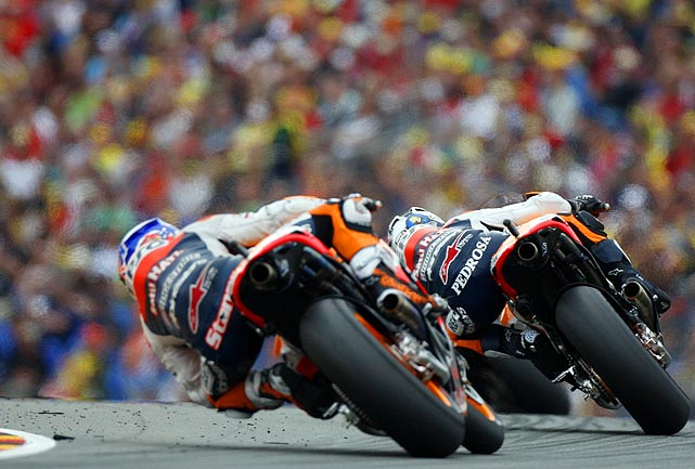 Spanish rider Dani Pedrosa, right, and Australian Casey Stoner sped around a corner at the Grand Prix of Germany MotoGP motorcycle race at the Sachsenring circuit in Hohenstein-Ernstthal, Germany. Pedrosa won the race while Stoner finished third.