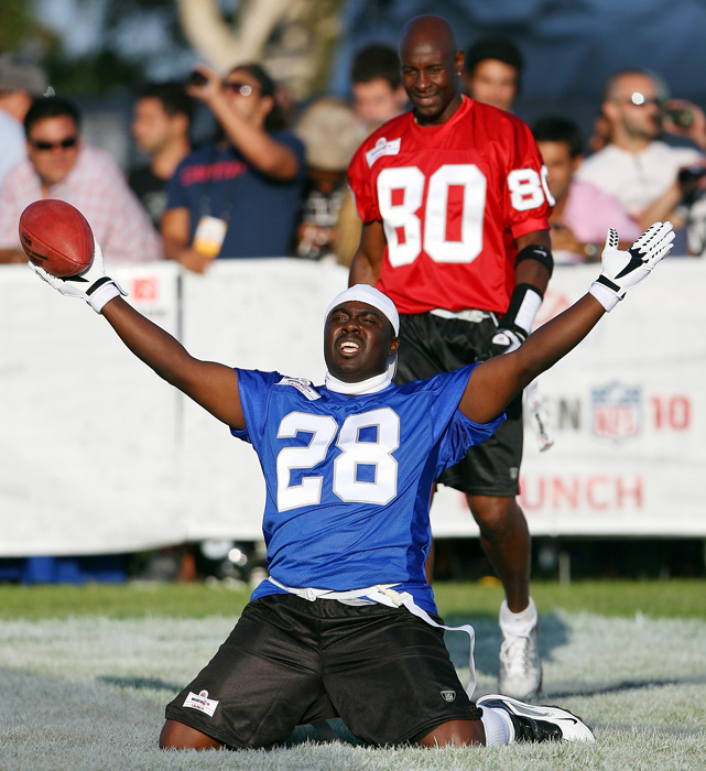 Faulk celebrates after scoring a touchdown in the EA Sports 2009 Madden NFL 10 Pigskin Pro-Am flag football game in Malibu, Calif.