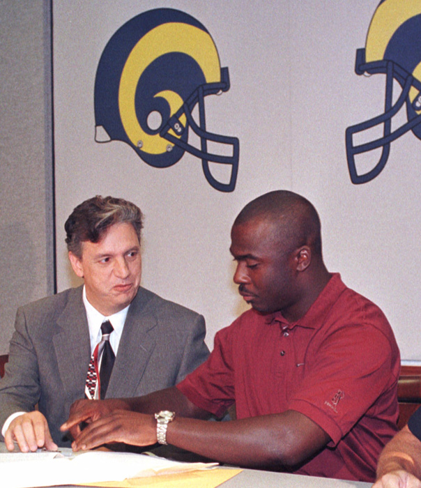 Two days before the 1999 draft, Faulk was traded to the Rams for a 2nd and 5th round draft pick. In August, he signed a seven-year contract worth $45.15 million.