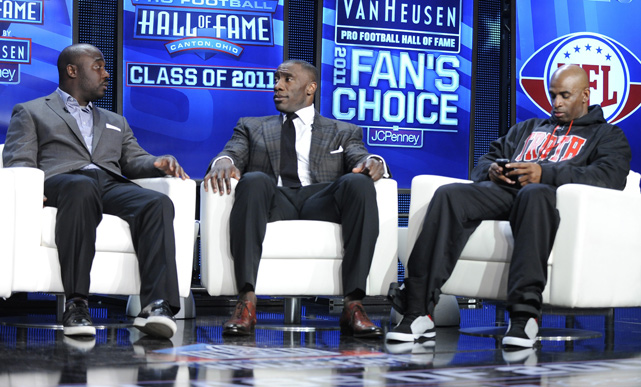 On Aug. 6, Faulk (far left) will be enshrined in the Pro Football Hall of Fame along with Shannon Sharpe (center) and Deion Sanders. Also being inducted are Richard Dent, Chris Hanburger, Les Richter and Ed Sabol.