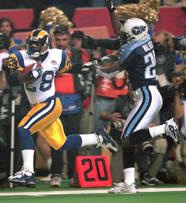 Though he only gained 17 yards on the ground, Faulk caught five passes for 90 yards as the Rams beat the Titans in Super Bowl XXXIV.
