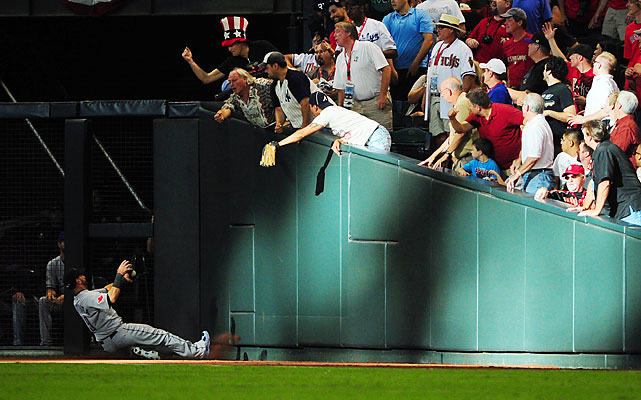 Jose Bautista made the first highlight of the night, sliding into the right-field wall (and scaring Jays fans across Canada) to snare a foul flyball in the second inning.
