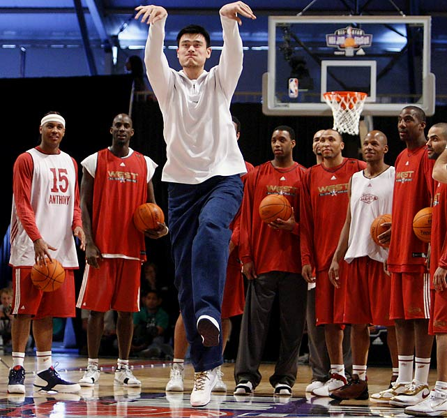 Yao Ming shoots a half-court shot in front of teammates during a Western Conference practice for the 2007 NBA All-Star game in Las Vegas.
