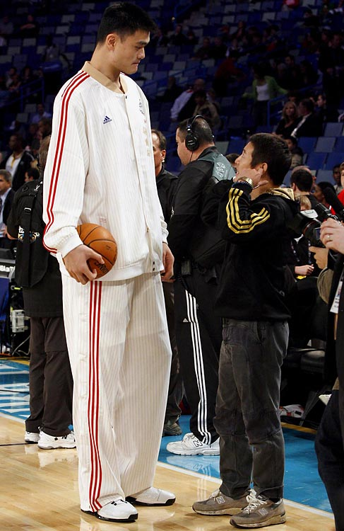 Yao Ming talks with actor Jet Li prior to the start of the 57th annual NBA All-Star game in New Orleans.
