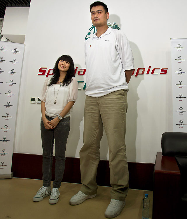 Actress Zhang Ziyi poses with Yao Ming for photos after attending a departure ceremony for the Chinese athletes with disabilities at the China Administration of Sports for Person with Disabilities (CASPD) in Beijing.