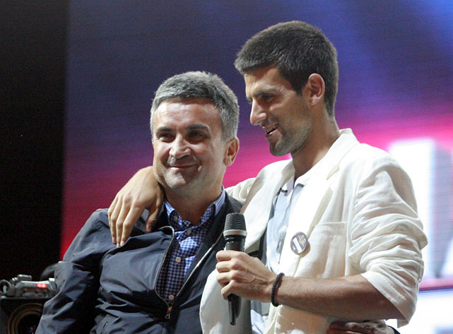Novak Djokovic appears with his father, Srdjan, during Monday's ceremony.
