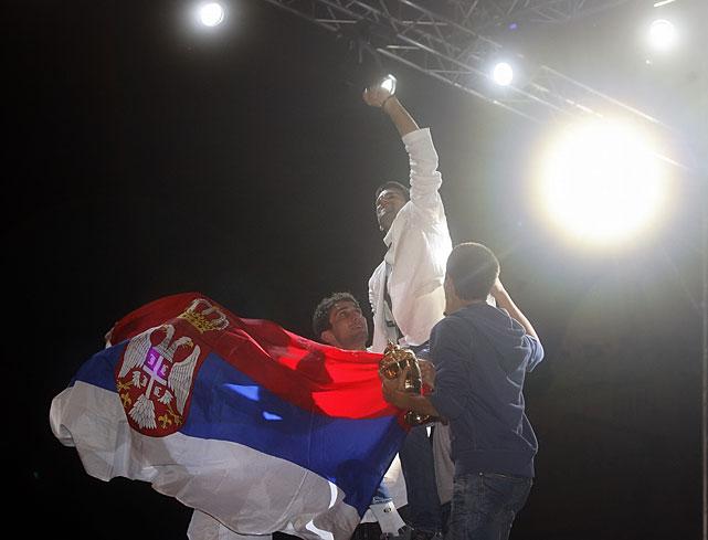 Novak Djokovic celebrates with the Serbian flag.