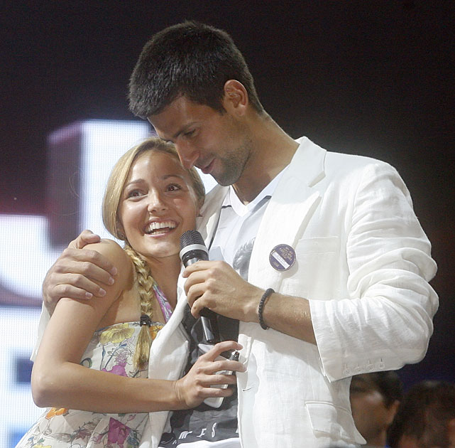 Novak Djokovic celebrates with girlfriend Jelena Ristic during Monday's ceremony.
