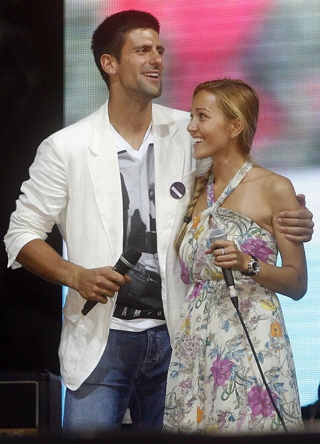 Novak Djokovic celebrates with girlfriend Jelena Ristic at Monday's homecoming.