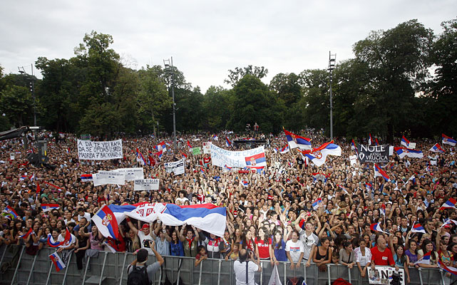 """Many young people had gathered outside the Serbian parliament, waving flags of Serbia and placards that read: """"Nola, we love you"""" or """"Nole, the king"""" in reference to his nickname."""