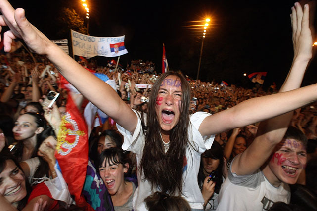 A female fan celebrates at a welcoming ceremony for Novak Djokovic.