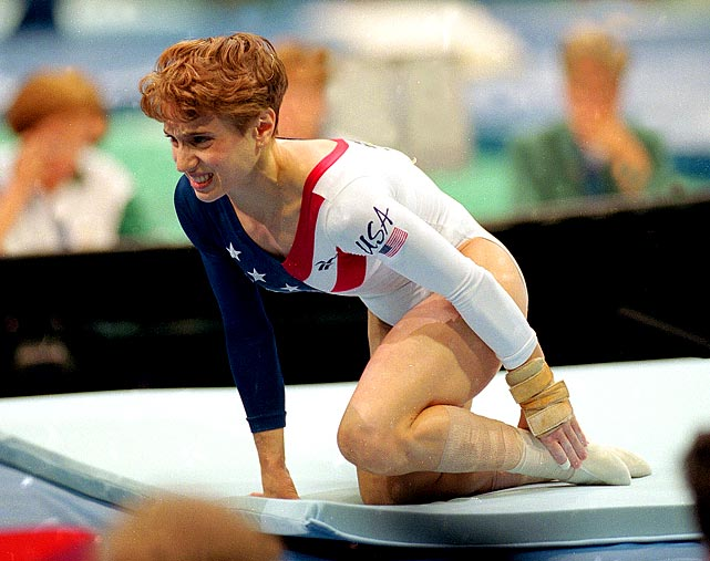Gymnast Kerri Strug holds her ankle after a painful landing during the 1996 Atlanta Olympics.