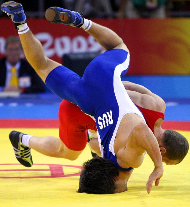 Wrestler Mavlet Batirov of Russia gets thrown straight into the mat by Ukraine's Vasyl Fedoryshyn during the 2008 Beijing Olympics.