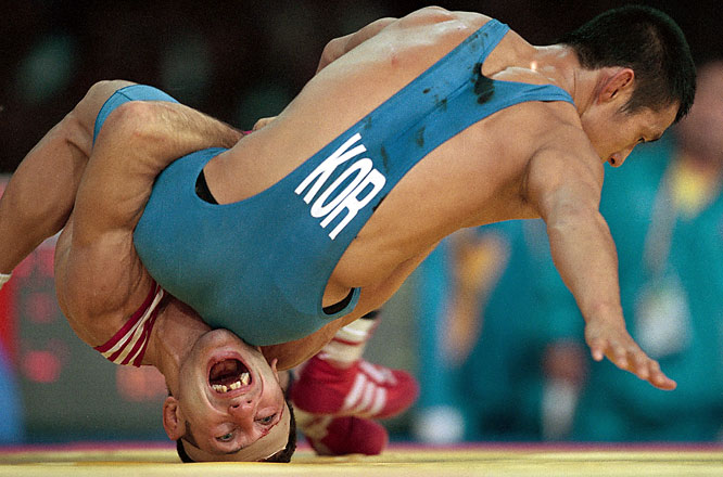 Greco-Roman wrestler Yuri Melnichenko of Kazakhstan screams in pain during the 2000 Sydney Olympics.