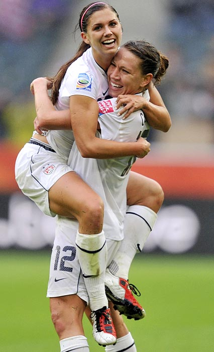 Alex Morgan, left, is embraced by teammate Lauren Cheney after Morgan's goal in the 82nd minute put the game out of France's reach. It was the first World Cup goal of Morgan's career.