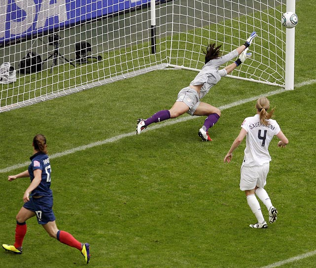 Euginie Le Sommer, left, failed to connect with a cross from teammate Sonia Bompastor (not pictured) -- but so too did U.S. goalkeeper Hope Solo, who watched the France tie the game 1-1 in the 55th minute.