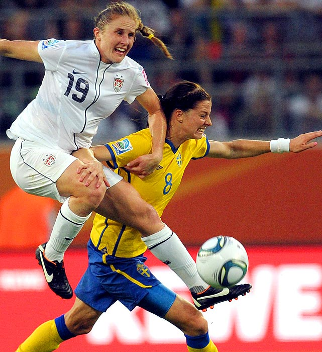 American defender Rachel Buehler battles for the ball with Sweden's Lotta Schelin during the final match of the group stage on July 6. Sweden would win the game, 2-1.