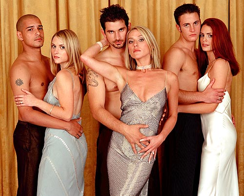 """The British sports soap combo aired five seasons (2002-2006), following the catty antics of the wives of fictitious Earl's Football Club. Amazon asks, """"What do customers view after buying this item?"""" Result: Desperate Housewives... and more Footballers' Wives."""