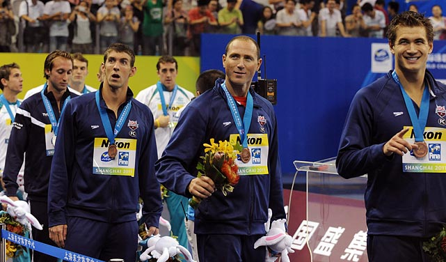 Nathan Adrian, Garrett Weber-Gale, Jason Lezak and Michael Phelps attend the medal presentation ceremony after winning third in the 4x100m freestyle relay.