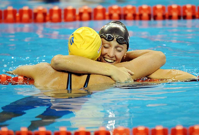 Dana Vollmer of the U.S. was the first American to win a gold medal at the world championships, triumphing in the 100-meter butterfly. Vollmer fought through numerous health issues to reach the world championships.