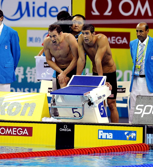 Michael Phelps watches in disbelief as his relay team falls behind the Australians and French in the 4x100m freestyle relay.