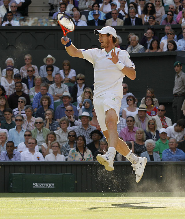 Great Britain's Andy Murray returns a shot to Spain's Rafael Nadal during their semifinal match.