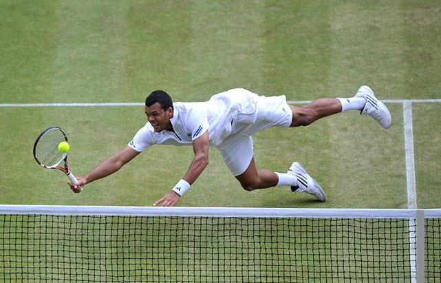 Jo-Wilfried Tsonga dives to make a shot against Novak Djokovic during Friday's semifinal.