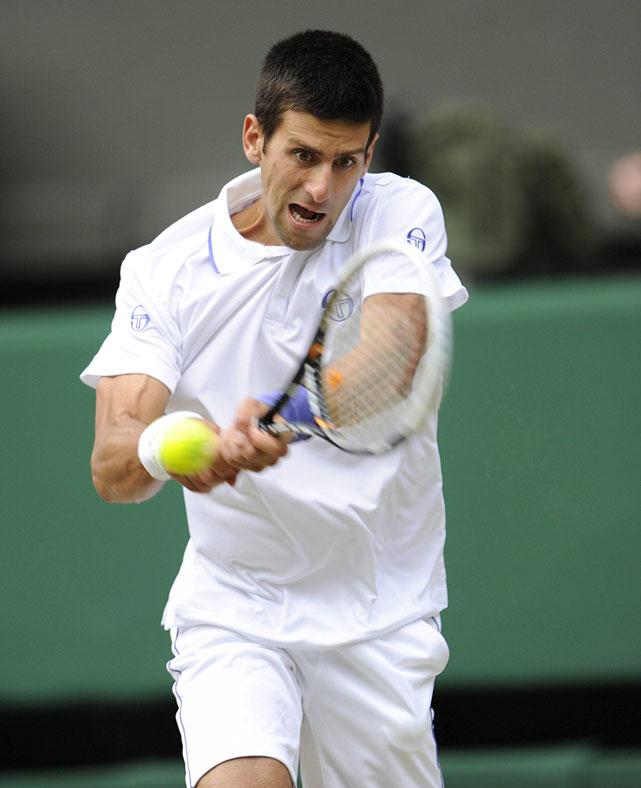 Novak Djokovic returns a shot to Jo-Wilfried Tsonga.