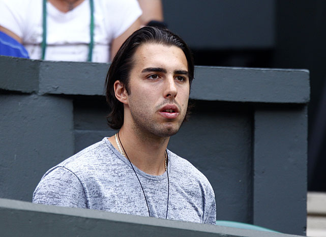 Maria Sharapova's fiancee Sasha Vujacic watches Saturday's match from the players' box on Centre Court.