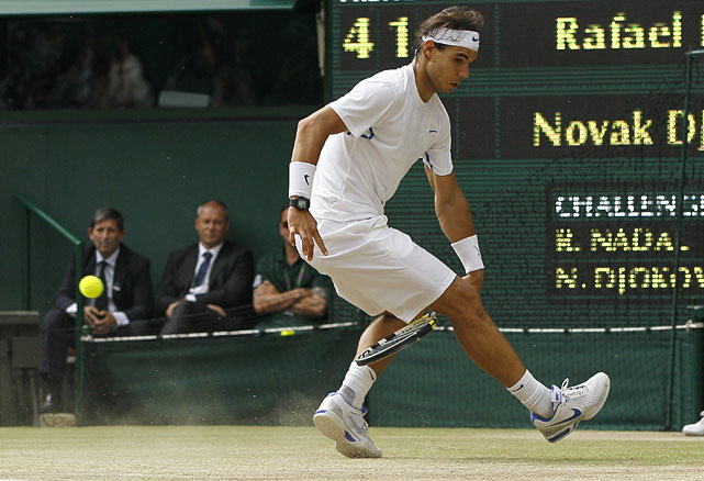 Rafael Nadal plays a shot through his legs during Sunday's men's singles final.