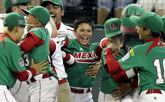 Mexico's Bruco Ruiz, center, celebrates with his team after hitting the game-winning walk-off single, scoring Jorge Jacobo, in the seventh inning of a game against Hamamatsu City, Japan.
