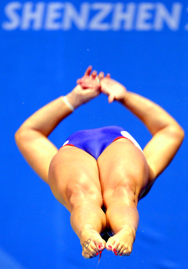 University of Minnesota's Kelci Bryant (with an Olympic Rings tattoo on her foot) competes in the women's 1m springboard prelims.