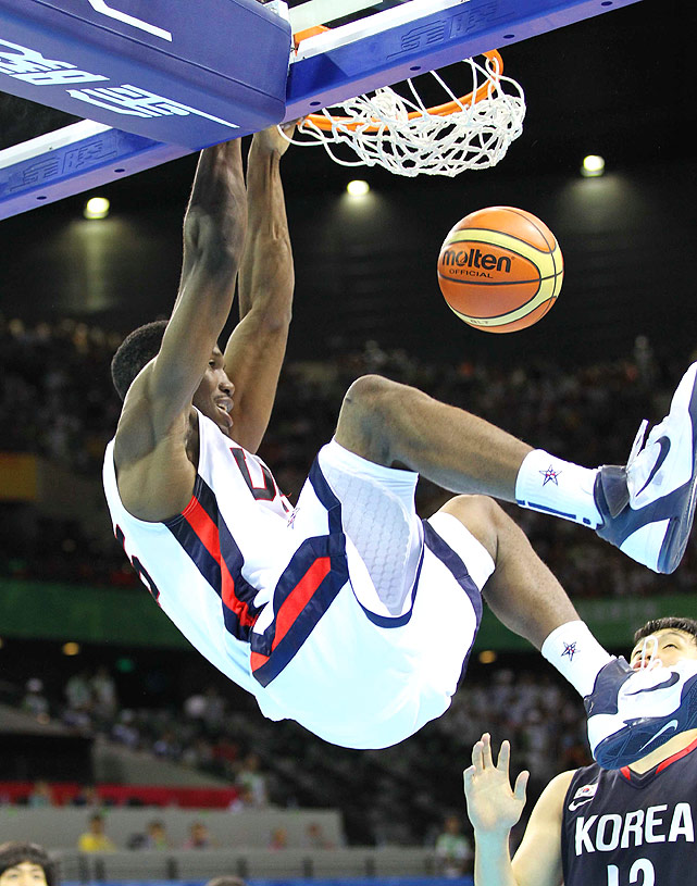 University of Minnesota's Trevor Mbakwe slam dunks in a preliminary round game against South Korea. The U.S. won by a landslide, 112-68.