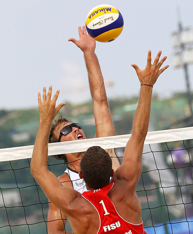 University of Southern California's Maddison McKibbin lays down a spike during a men's beach volleyball match against Italy.